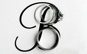 буква фамилии  с обручальным кольцом